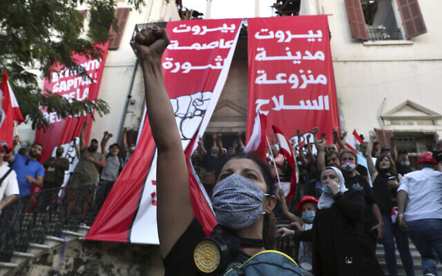 Anti-government protesters chant slogans outside the Lebanese foreign ministry in Beirut, Lebanon, August 8, 2020. (AP/Bilal Hussein)