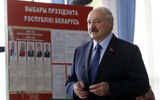 Belarusian President Alexander Lukashenko arrives to vote at a polling station during the presidential election in Minsk, Belarus, August 9, 2020. (AP Photo/Sergei Grits)