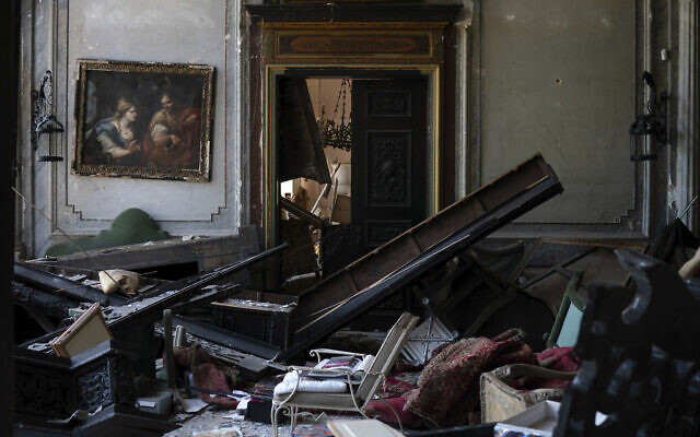 A painting hangs on the wall of a heavily damaged room in the Sursock Palace after the explosion in the seaport of Beirut, Lebanon, Aug. 8, 2020 (AP Photo/Felipe Dana)