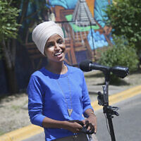 Democrat Rep. Ilhan Omar addresses media after lunch at the Mercado Central in Minneapolis, Minnesota, on August 11, 2020, primary election day in Minnesota. (AP Photo/Jim Mone)