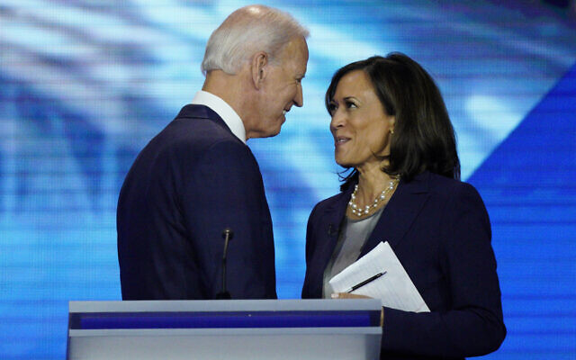 In this Sept. 12, 2019, file photo, Democratic presidential candidate former Vice President Joe Biden, left, and then-candidate Sen. Kamala Harris, D-Calif. shake hands after a Democratic presidential primary debate hosted by ABC at Texas Southern University in Houston. Biden has chosen Harris as his running mate. (AP Photo/David J. Phillip, File)