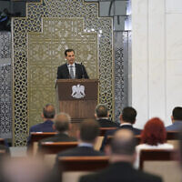 Syrian President Bashar al-Assad addresses the parliament, in Damascus, Syria, August 12, 2020. (SANA via AP)