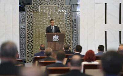 Syrian President Bashar al-Assad addresses the parliament, in Damascus, Syria, August 12, 2020. (SANA via AP)