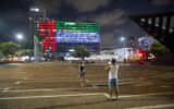 Tel Aviv City Hall is lit up with the flags of the United Arab Emirates and Israel as the countries announced they would be establishing full diplomatic ties, on August 13, 2020. (AP Photo/Oded Balilty)