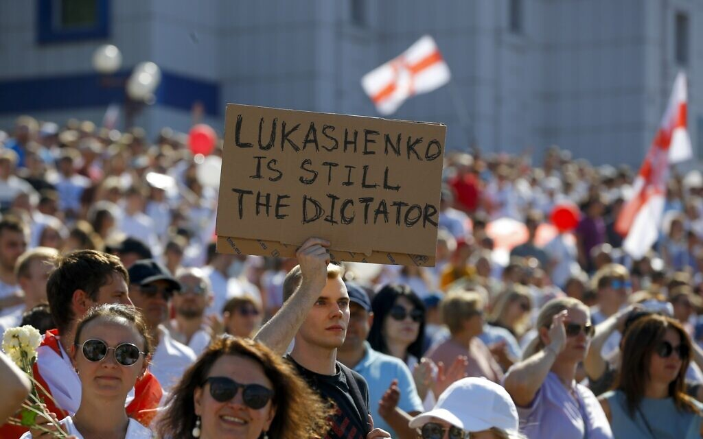 Illustrative: Belarusian opposition supporters rally in the center of Minsk, Belarus, on August 16, 2020. (AP Photo/Sergei Grits)