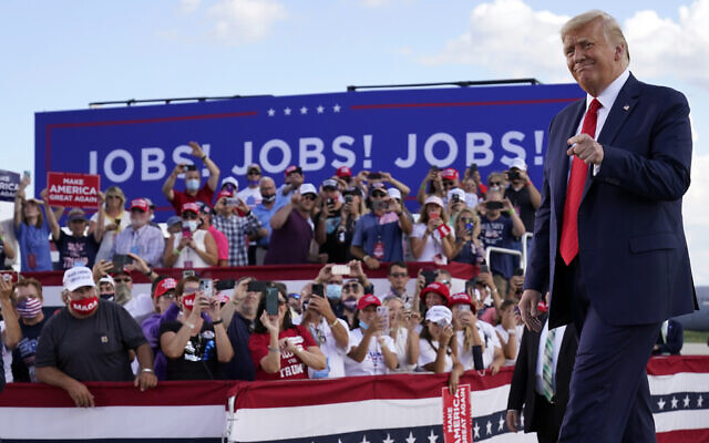 US President Donald Trump arrives to speak at a campaign rally at Wittman Airport, Monday, Aug. 17, 2020, in Oshkosh, Wisconsin (AP Photo/Evan Vucci)
