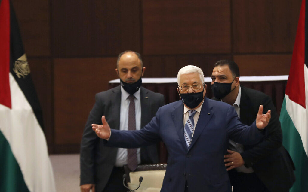 Palestinian Authority President Mahmoud Abbas gestures during a meeting with the Palestinian leadership to discuss the United Arab Emirates' deal with Israel to normalize relations, in the West Bank city of Ramallah on Tuesday, Aug. 18, 2020. (Mohamad Torokman/Pool Photo via AP)