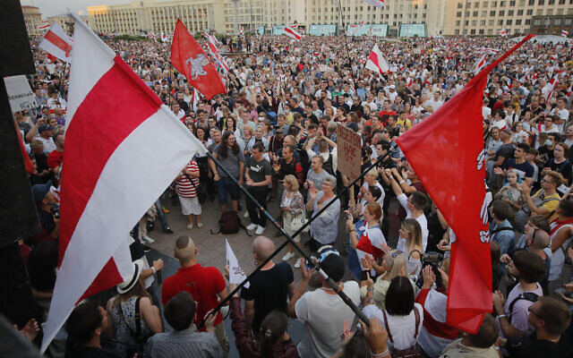 Belarusian opposition supporters gather for a protest rally in front of the government building at Independent Square in Minsk, Belarus, August 18, 2020. (Dmitri Lovetsky/AP)