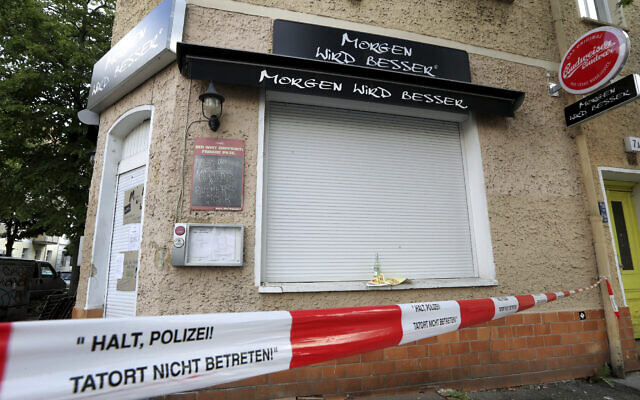 Exterior view of the burnt out bar 'Morgen Wird Besser' (Tomorrow will be better) pictured in Berlin, Germany, Aug. 19, 2020. (AP Photo/Michael Sohn)