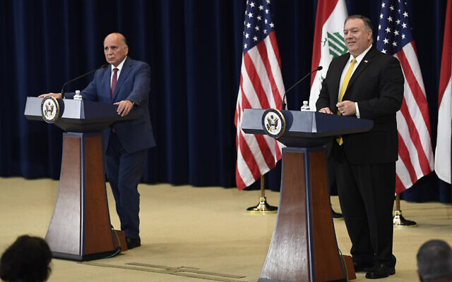 US Secretary of State Mike Pompeo, right, speaks during a news conference with Iraqi Foreign Minister Fuad Hussein, left, at the State Department in Washington, August 19, 2020. (Susan Walsh/AP)