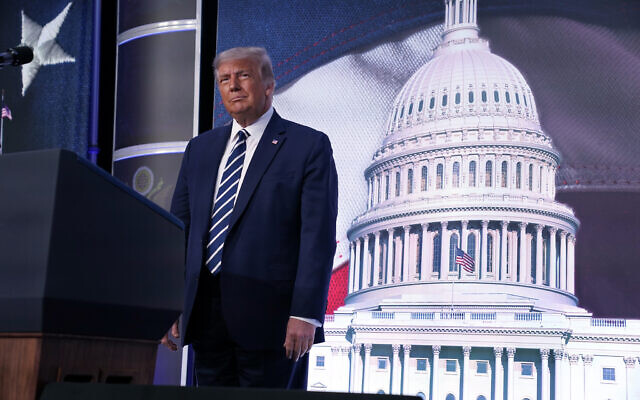 US President Donald Trump stands on stage during the 2020 Council for National Policy Meeting, Aug. 21, 2020, in Arlington, Virginia. (AP Photo/Evan Vucci)