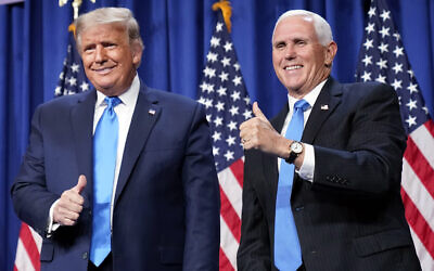US President Donald Trump and Vice President Mike Pence stand on stage during the first day of the 2020 Republican National Convention in Charlotte, N.C., Monday, Aug. 24, 2020. (AP Photo/Andrew Harnik)
