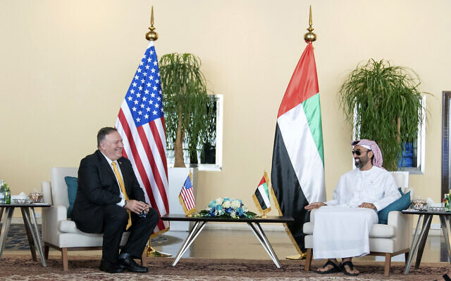 In this photo provided by Ministry of Presidential Affairs/WAM, US Secretary of State Mike Pompeo, left, meets United Arab Emirates national security adviser Sheikh Tahnoun bin Zayed Al Nahyan at Al-Shati Palace in Abu Dhabi, United Arab Emirates, August 26, 2020. (Rashed al-Mansoori/Ministry of Presidential Affairs/WAM via AP)