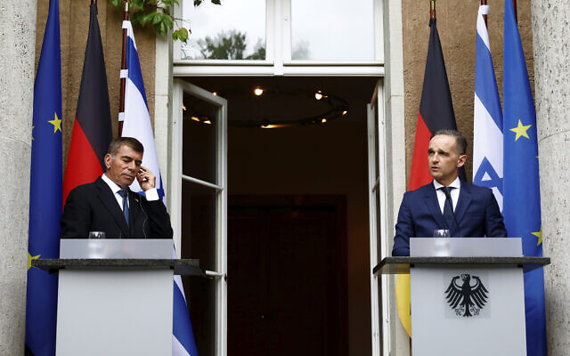 German Foreign Minister Heiko Maas (R) and Foreign Minister Gabi Ashkenazi attend a news conference in front of the Liebermann Villa at the Wannsee lake in Berlin, Germany, August 27, 2020. (Michele Tantussi/Pool Photo via AP)