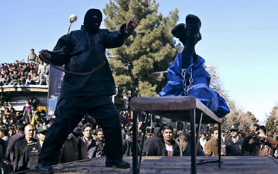 Illustrative: An Iranian officer lashes a man, convicted of rape, at the northeastern city of Sabzevar, Iran, Wednesday, Jan. 16, 2013. (AP Photo/Hossein Esmaeli)