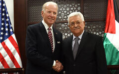 Then-US Vice President Joe Biden, left, and Palestinian Authority President Mahmoud Abbas, shake hands for the press at the presidential compound in Ramallah, West Bank, Wednesday, March 9, 2016. (Debbie Hill, Pool via AP)