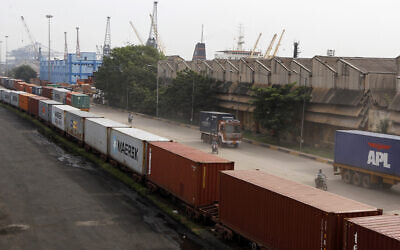 File: Shipping containers at Chennai's port in India, Friday, Sept. 19, 2014 (AP Photo/Arun Sankar K)