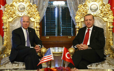 Then-US vice president Joe Biden, left, poses for photographers with Turkish President Recep Tayyip Erdogan, right, prior to a meeting at Yildiz Mabeyn Palace in Istanbul on January 23, 2016. (Kayhan Ozer/ Presidential Press Service, Pool via AP)