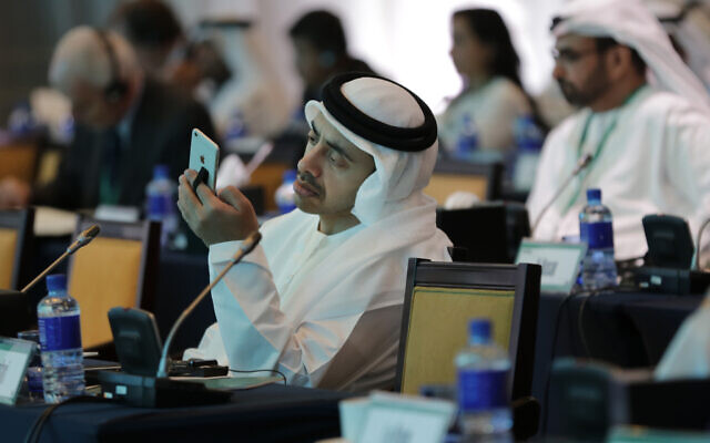 United Arab Emirates Foreign Minister Sheik Abdullah bin Zayed Al Nahyan checks his phone during the 10th International Institute for the Strategic Studies in Manama, Bahrain,  December 6, 2014. (AP Photo/Hasan Jamali/File)