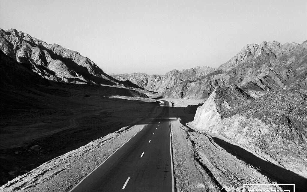 Driving on a deserted highway in pre-state Israel (Courtesy The Photo House)