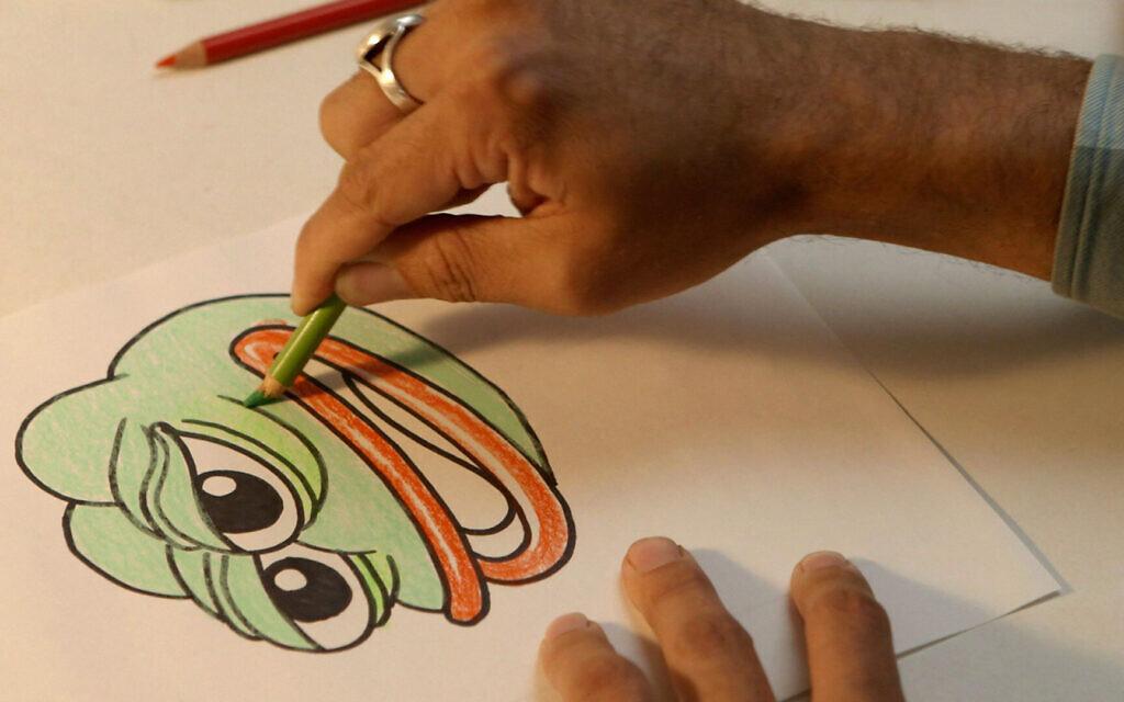 Artist Matt Furie draws the Pepe the Frog character in the new documentary 'Feels Good Man.' (Kurt Keppeler)