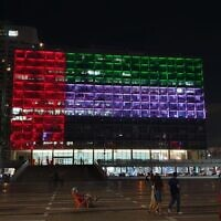 The Tel Aviv municipality building lights up with the UAE flag on August 13, 2020, after the announcement of the Israel-UAE normalization deal brokered by the US. (Tel Aviv municipality/Twitter)