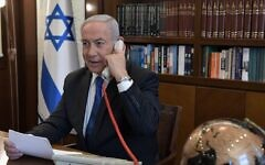 Illustrative: Prime Minister Benjamin Netanyahu at his office in Jerusalem on a phone call with UAE leader Mohammed Bin Zayed on August 13, 2020. (Kobi Gideon/PMO)