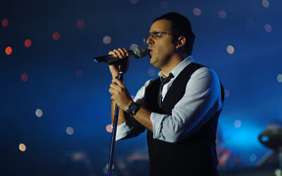 Singer Yaakov Shwekey performing live during a concert at the Yad Eliyahu Arena in Tel Aviv, January 2, 2012. (Mendy Hectman/Flash90)