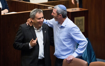 Rafi Peretz (right) with Zeev Elkin in the plenum hall of the Knesset in Jerusalem, June 3, 2019 (Yonatan Sindel/Flash90)