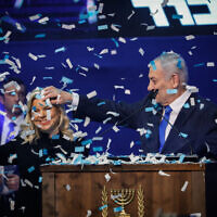 Prime Minister Benjamin Netanyahu and his wife Sara celebrating election night in Tel Aviv on March 3, 2020. (Olivier Fitoussi/Flash90)