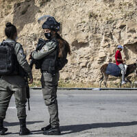 Illustrative: Border Police officers stand guard on a West Bank checkpoint on April 22, 2020. (Olivier Fitoussi/FLASH90)
