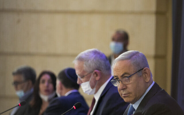 Prime Minister Benjamin Netanyahu and Alternate Prime Minister and Minister of Defense Benny Gantz at the weekly cabinet meeting, at the Ministry of Foreign Affairs in Jerusalem on June 28, 2020. (Olivier Fitoussi/Flash90)
