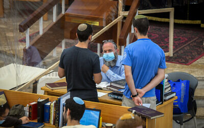 Illustrative: Jewish men study torah in small groups at the Orot Shaul Yeshiva in Tel Aviv on July 7, 2020. (Yossi Zeliger/Flash90)