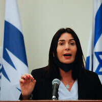 Transportation Minister Miri Regev, who lowered her face mask to speak, during a press conference at the Transportation Ministry in Jerusalem on July 8, 2020. (Olivier Fitoussi/Flash90)