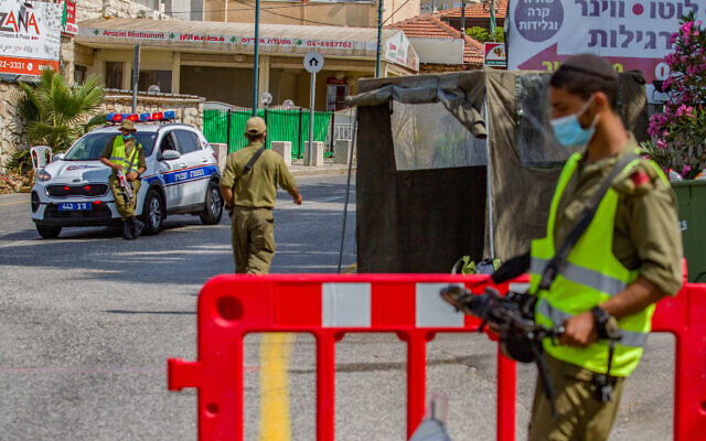 Israeli soldiers guard at a roadblock in the upper Galilee in northern Israel on July 27, 2020. (Flash90)