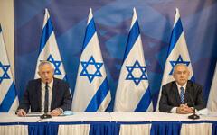 Prime Minister Benjamin Netanyahu, left and Alternate Prime Minister Defense Benny Gantz hold a press conference in Tel Aviv on July 27, 2020.  (Tal Shahar/POOL/Flash90)