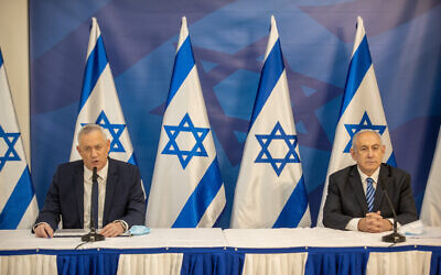 Prime Minister Benjamin Netanyahu, right, and Defense Minister Benny Gantz hold a press conference in Tel Aviv on July 27, 2020. (Tal Shahar/Pool/Flash90)