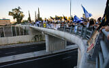Israelis protest against Prime Minister Benjamin Netanyahu on the Sde Yaakov bridge in the Jezreel Valley, northern Israel, on August 1, 2020. (Anat Hermony/Flash90)