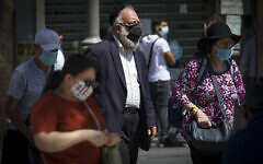 Jerusalemites wearing face masks for fear of coronavirus on Jaffa Road in the center of Jerusalem on August 2, 2020. (Olivier Fitoussi/Flash90)