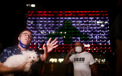 Tel Aviv city hall, on Rabin Square, is lit up with the Lebanese flag, in solidarity with the victims of the Beirut explosion, on August 5, 2020. (Miriam Alster/Flash90)