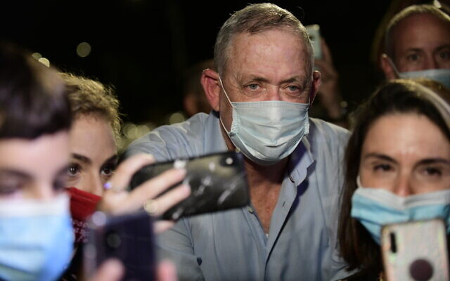 Defense Minister Benny Gantz speaks to the media outside his home, during a protest by Israelis from the culture and art industry demanding the restarting of performances amid the COVID-19 pandemic, in Rosh Haayin, on August 9, 2020. (Tomer Neuberg/Flash90)