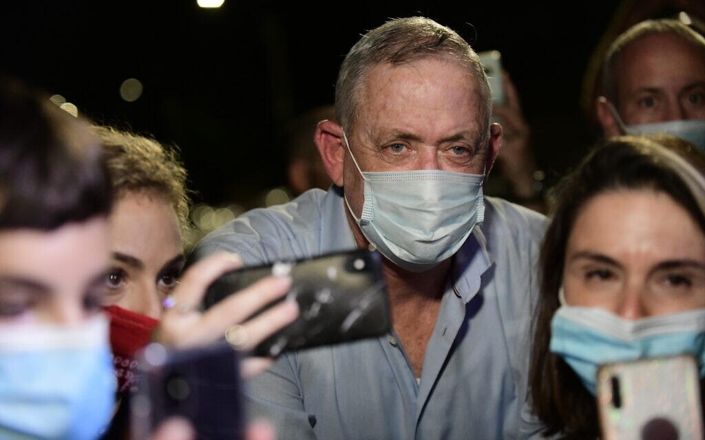 Defense Minister Benny Gantz speaks to the media outside his home in Rosh Haayin, during a protest by Israelis from the culture and art industry demanding the restarting of performances amid the COVID-19 pandemic, on August 9, 2020. (Tomer Neuberg/Flash90)