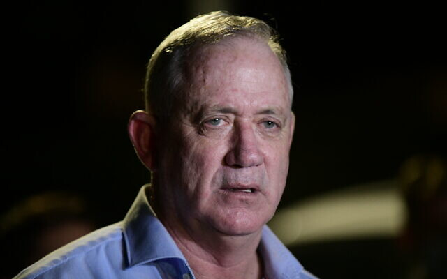 Defense Minister Benny Gantz speaks to the media outside his home in Rosh Haayin, August 9, 2020. (Tomer Neuberg/ Flash90)