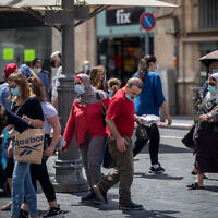 People walk with face masks on Jaffa street in Jerusalem on August 10, 2020. (Yonatan Sindel/Flash90)