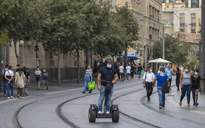 People walk in Jerusalem on August 12, 2020 (Olivier Fitoussi/Flash90)