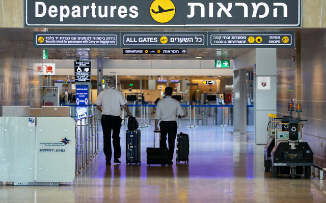 Travelers head to the departure area at Ben Gurion Airport on August 17, 2020. (Olivier Fitoussi/Flash90)