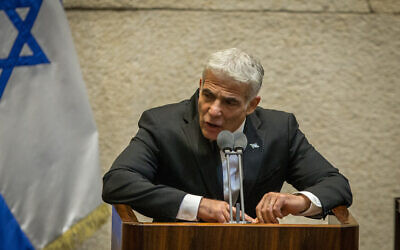 Yesh Atid leader MK Yair Lapid speaks in the Knesset plenum in Jerusalem on August 24, 2020. (Oren Ben Hakoon/Pool)