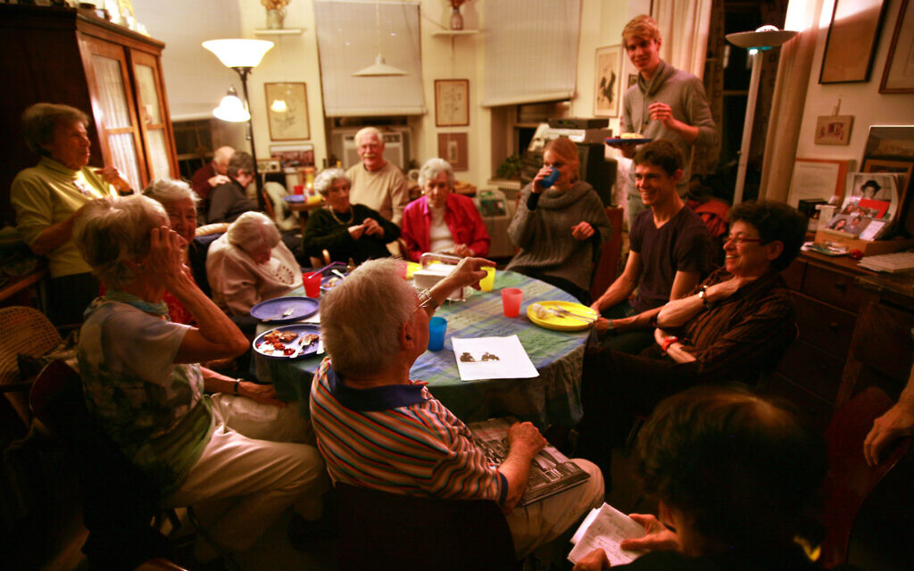 The weekly Stammtisch meetings, hosted in this photo by Gaby Glueckselig in 2015, draw young and old alike. (Courtesy Shani Bar On/ from 'Almost a Ritual' by Emil Rennert)