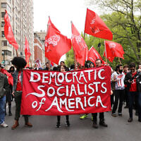 Illustrative: Members of the Democratic Socialists of America gather outside of a Trump-owned building on May Day on May 01, 2019 in New York City. (Photo by Spencer Platt/Getty Images via JTA)
