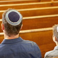 Illustrative: Jewish people at a synagogue. ((Robert Nicholas/Getty Images via JTA)
